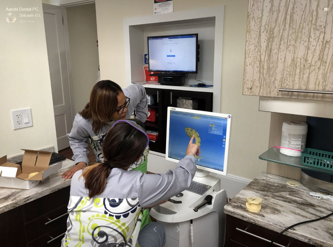 2 Hygienists studying a chart